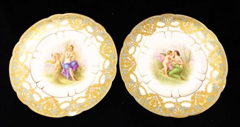 """Cherub scenes. Bear mark on back. Both plates show wear on rims. 9.5"""" diameter. Signed.  Sèvres porcelain, French hard-paste, or true, porcelain as well as soft-paste porcelain (a porcellaneous material rather than true porcelain) made at the"""