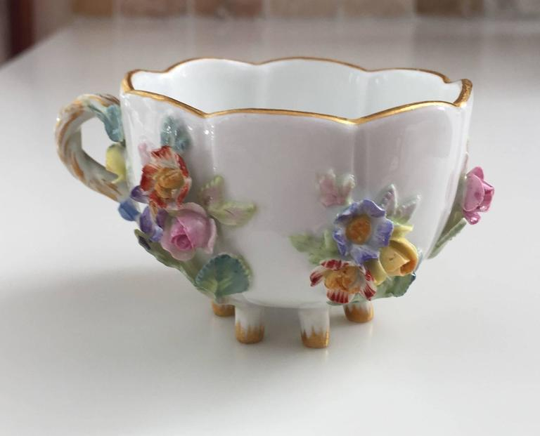19th century Meissen cup and saucer Floral with gold gilt accent.