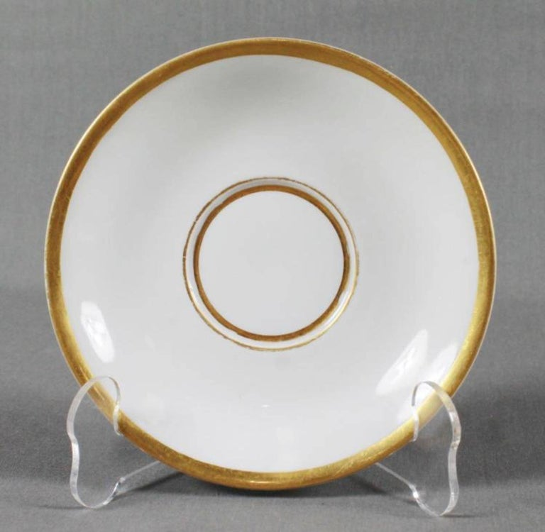 19th century Meissen cup and saucer, painted with a nautical scene and trimmed in gold gilt. Cup measures H: 2 1/2in and the saucer measures 5 1/2in diameter.
