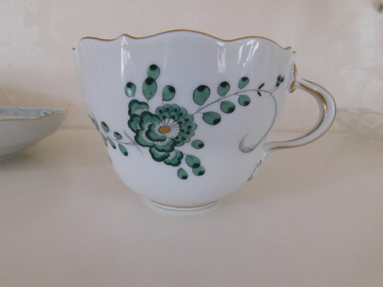 Meissen porcelain green Indian flowers large cup and saucer, hand-painted in the Indian painting pattern with green leaf and flower decorations with gold trim 20th Century  Cup 3.5 In. D x 2.5 In. H Saucer 5.63 In. D x 1.25 In. H Meissen porcelain