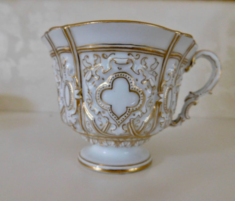 Gilt Early 20th Century Meissen Porcelain Heavy Gold Trim Embossed Cup and Saucer