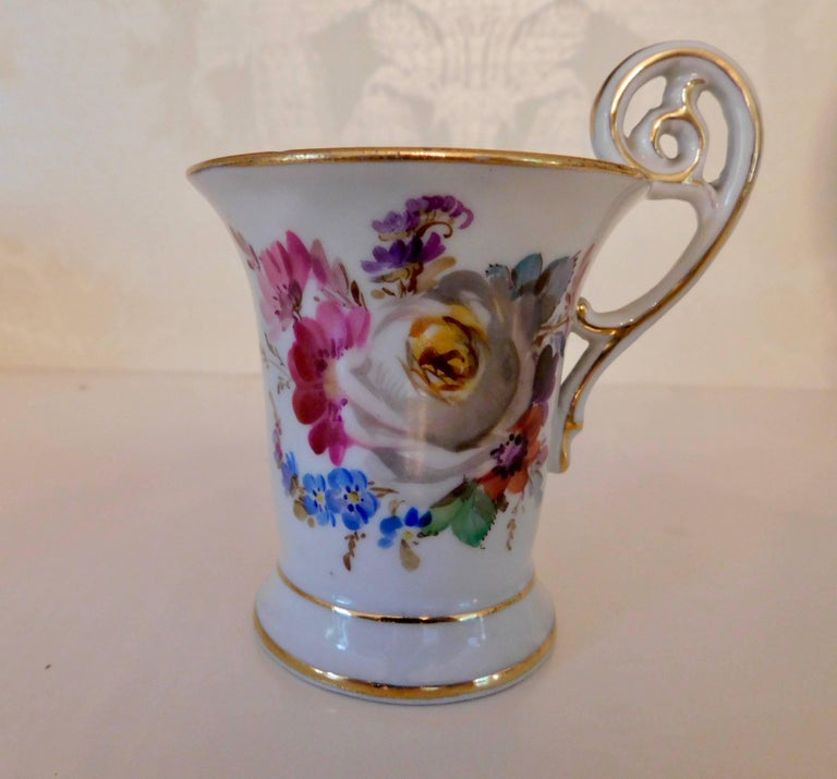 20th century Meissen Porcelain demitasse cup and saucer Beautiful painted floral pattern with gold trim. Measurements in inches: Cup 2.13 D x 3.75 H Saucer 4.5 D x 1 H.