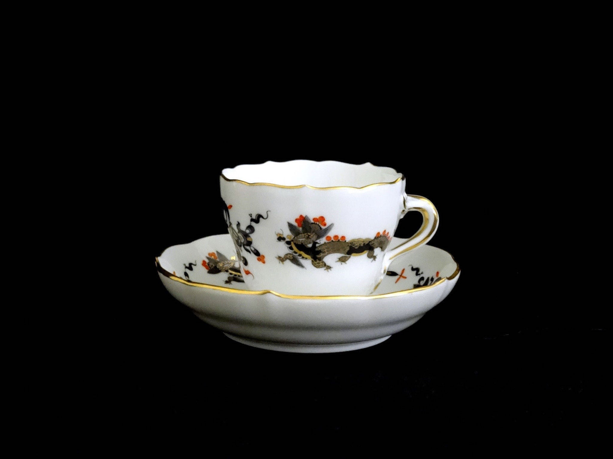 Meissen Black Dragon Red Accent Demitasse Cup and Saucer For Sale at