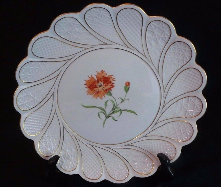 19th century antique Meissen porcelain plate with scalloped edge and gold accent.