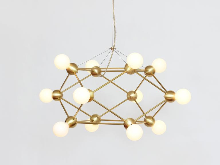 Inspired by 1960s Italian lighting, Lina is an all-brass lighting system designed to create airy geometric fixtures.  Each welded brass sphere joins with solid brass tubing and minimal fastener hardware to form strikingly simple hanging and