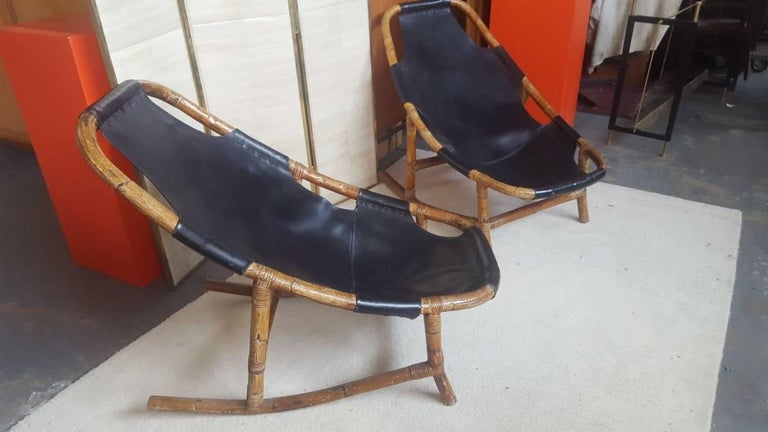 This pair of armchairs features bamboo structures and leather upholstery, and was produced in Italy, circa 1960.