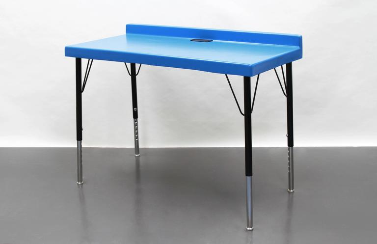 The 104 desk is comprised of an Industrial fiberglass top and steel legs that are powder coated, have adjustable feet and are removable. The desktop is equipped with a grommet for cord access and the back rail is slightly curved to provide a resting