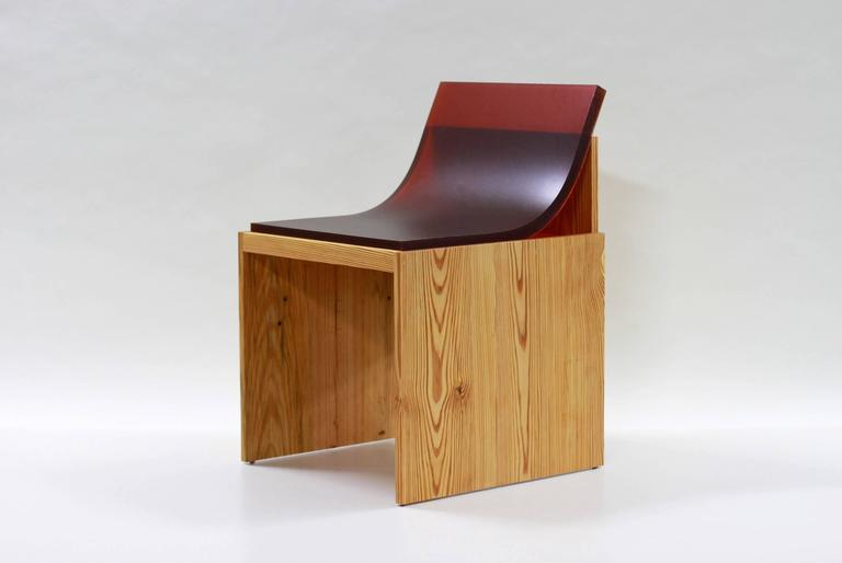 chair in hand oiled solid wood with cast industrial rubber slab seat