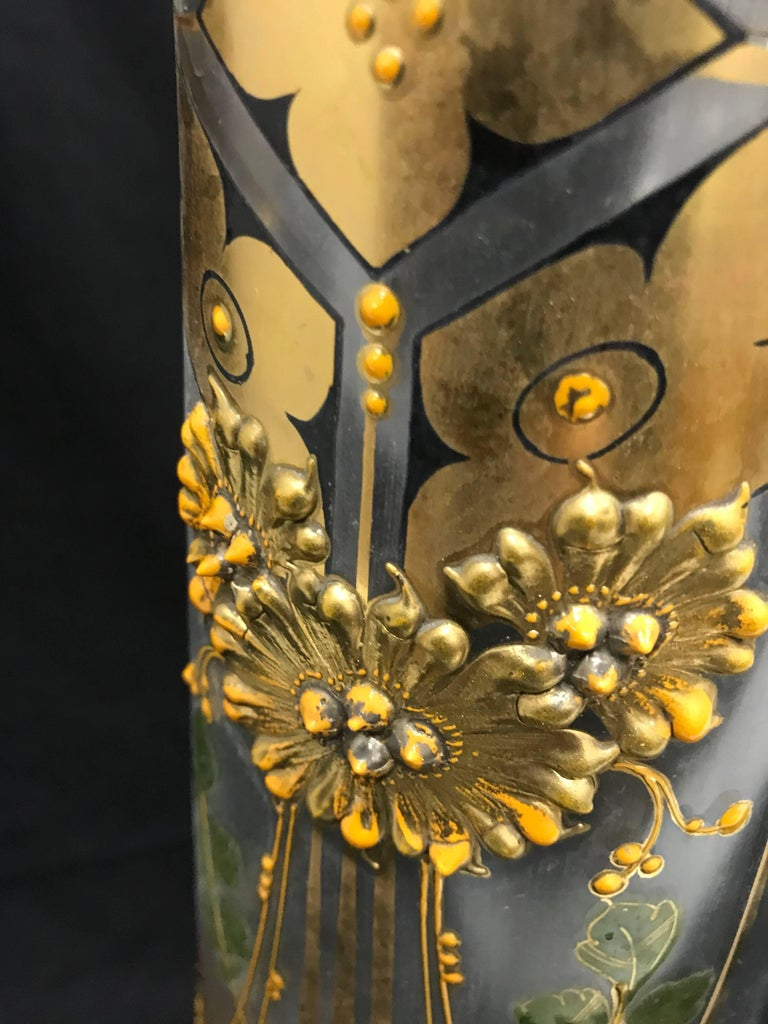Amazing glass jug, with gold handmade embossed floral decorations.