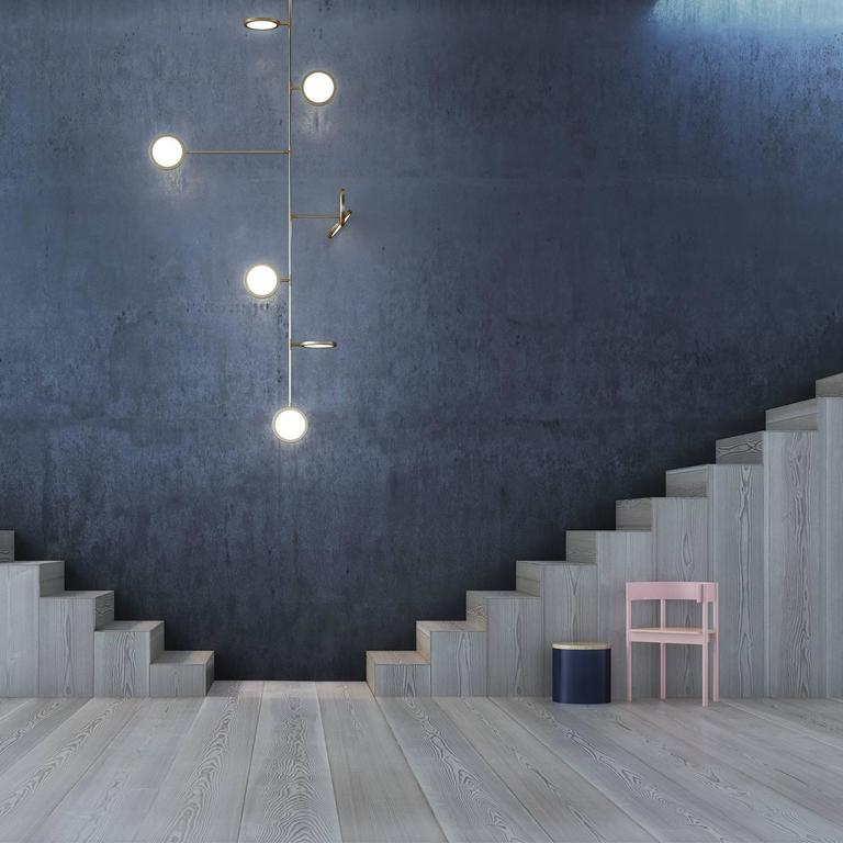 Discus is a spare and graphically compelling lighting collection. Made from modular components, the design is adaptable for spaces ranging from intimate to monumental. Dimmable LEDs cast a warm diffused light through both sides of each rotatable