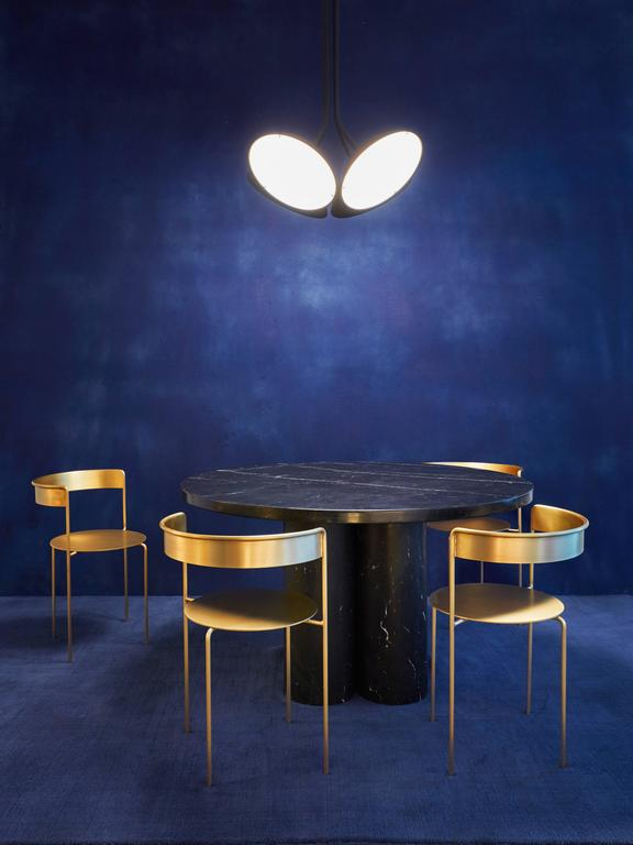 """The Slon collection takes two simple forms a tube and a slab to create a sculptural and minimal aesthetic that is fused with a whimsical approach to material and color.  Handcrafted in Italy from solid Nero Marquina marble.  Dimensions: L 51"""" x"""