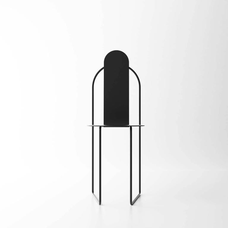 """Pudica chair is designed around the concept of """"modesty."""" Its Minimalist form and purified lines exude a silent religiosity while also recalling the curves and arches of traditional Portuguese architecture."""