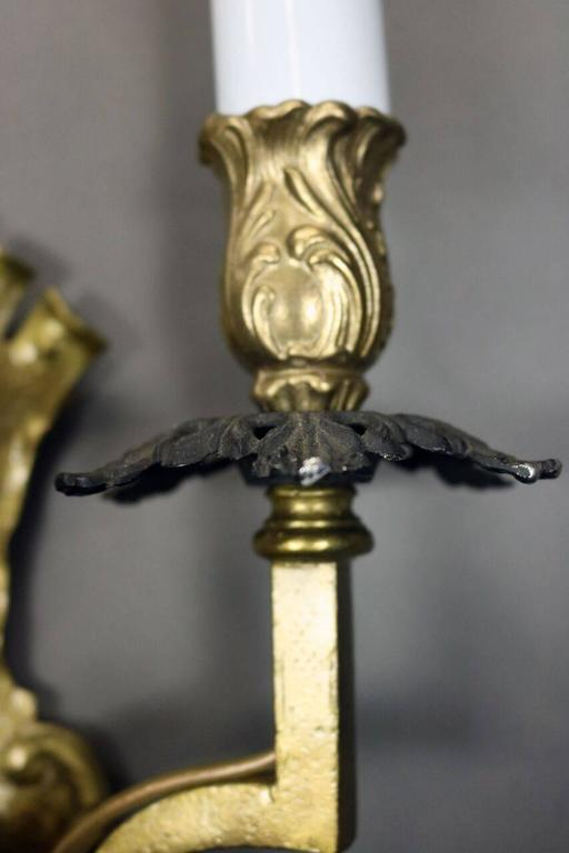 Pair of Antique Arts and Crafts Gothic Style Brass Three-Light Wall Sconces For Sale at 1stdibs