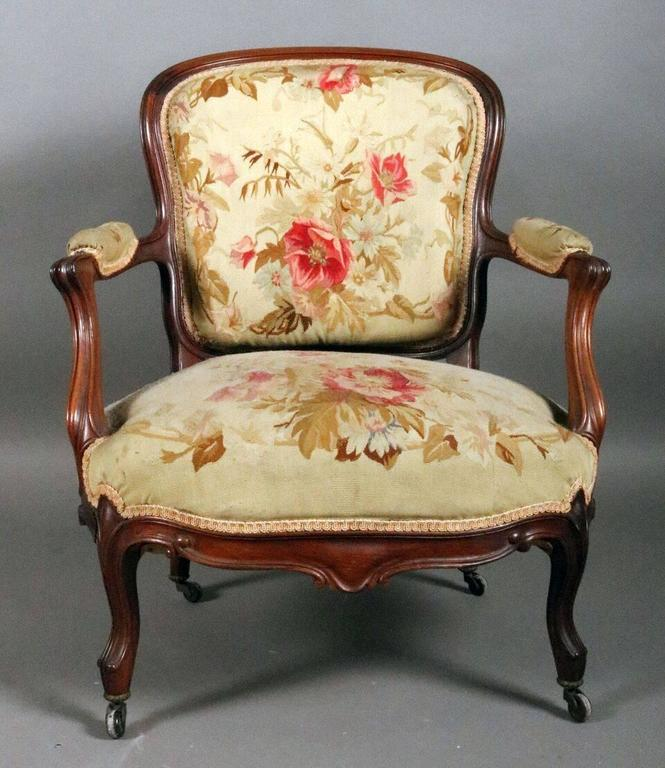 Pair Of Antique French Louis XV Fauteuil Armchairs Feature Carved Rosewood Frames With Original Floral Tapestry