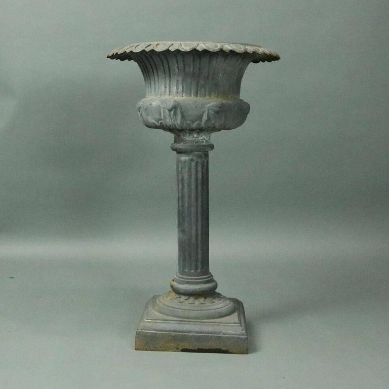 Pair of th century french cast iron pedestal garden