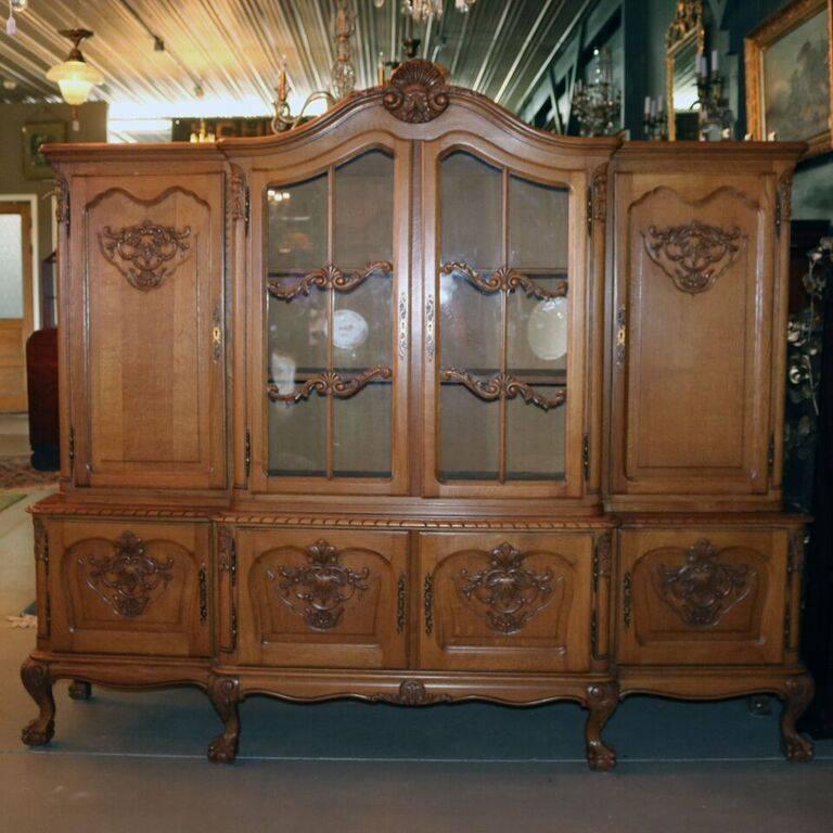 Oversized antique Belgian oak breakfront cabinet features upper cabinet  with central double glass doors over shelved - Oversized Antique Belgian Carved Oak Breakfront Cabinet, Circa 1940