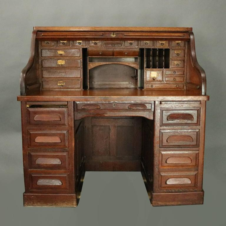 Antique roll top desk by The Standard Furniture Company features oak  construction with raised panels on - Antique Standard Furniture Co. Oak Raised Panel Roll Top Desk, Circa