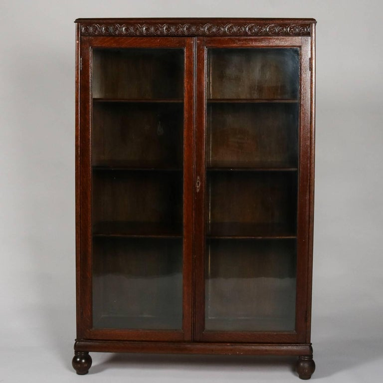 Antique oak bookcase by Horner Bros. features carved scroll and foliate  trim, two glass - Horner Bros. Carved Oak Enclosed Bookcase, Scroll And Foliate Trim