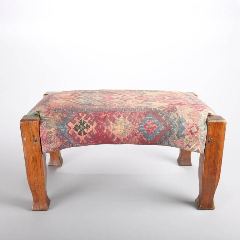 """Antique Arts & Crafts Stickley Bros. Mission footstool features oak frame with Native American tapestry design upholstered upper, circa 1910  Measures: 10.25"""" H x 20"""" W x 13"""" D."""