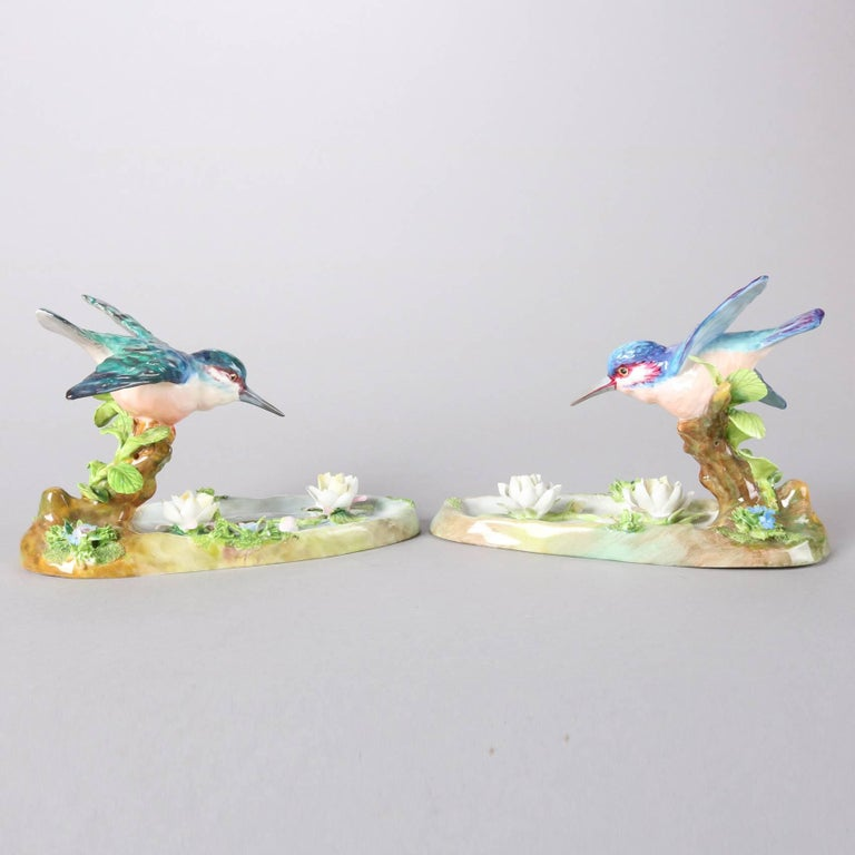 Pair of antique English Staffordshire hand painted porcelain King Fishers in flight by J. T. Jones, signed on bases, 20th century