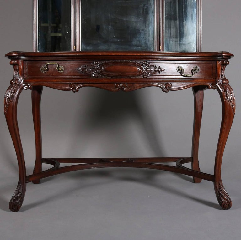 Antique mahogany vanity features carved foliate decoration, has central  drawer, triptych mirror, and - Antique Acanthus Carved Mahogany Triptych Mirrored Vanity, Circa