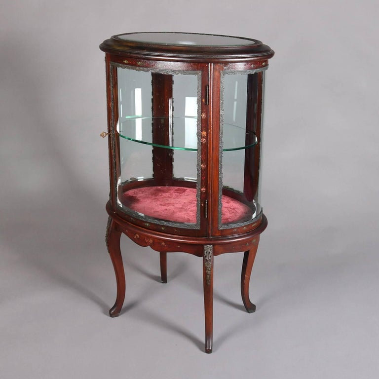 French Louis XV style petite curio features mahogany frame with Vernis Martin floral decoration and lake scene, seated on cabriole legs, and single front door opening to shelved interior with velvet lined base; ormolu mounts; beveled glass in door,
