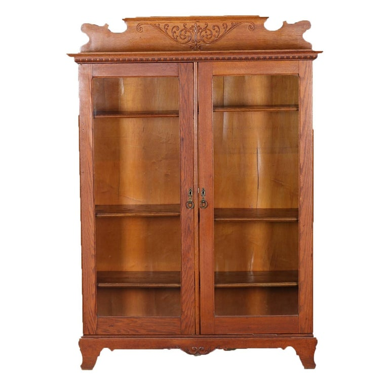 Antique Horner Bros, School Carved Oak Double Glass Door Bookcase, circa  1910 - Antique Eastlake Mahogany Two-Door Bookcase, Circa 1910 At 1stdibs