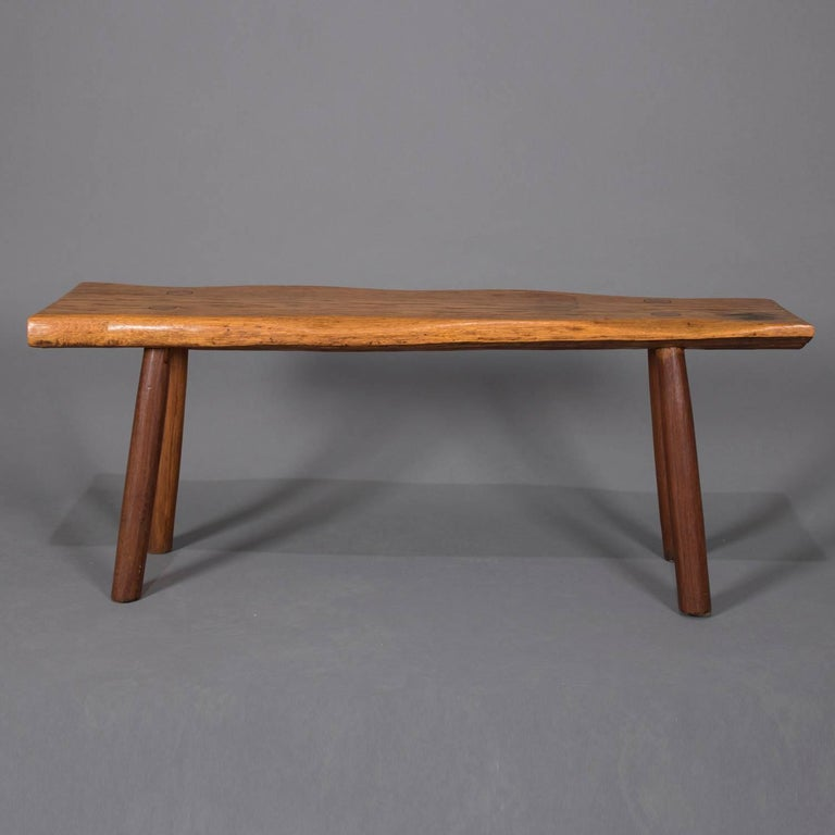 Adirondack Old hickory school hand-carved bench features slab wood seat with mortise and tenon legs, circa 1940.