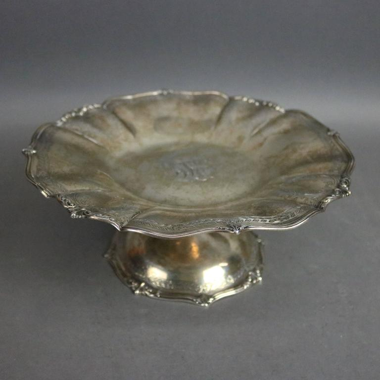 Antique sterling silver compote by The Frank Herschede Co. features scalloped edges with foliate decoration, central monogram BLE, circa 1880  ***DELIVERY NOTICE – Due to COVID-19 we are employing NO-CONTACT PRACTICES in the transfer of purchased