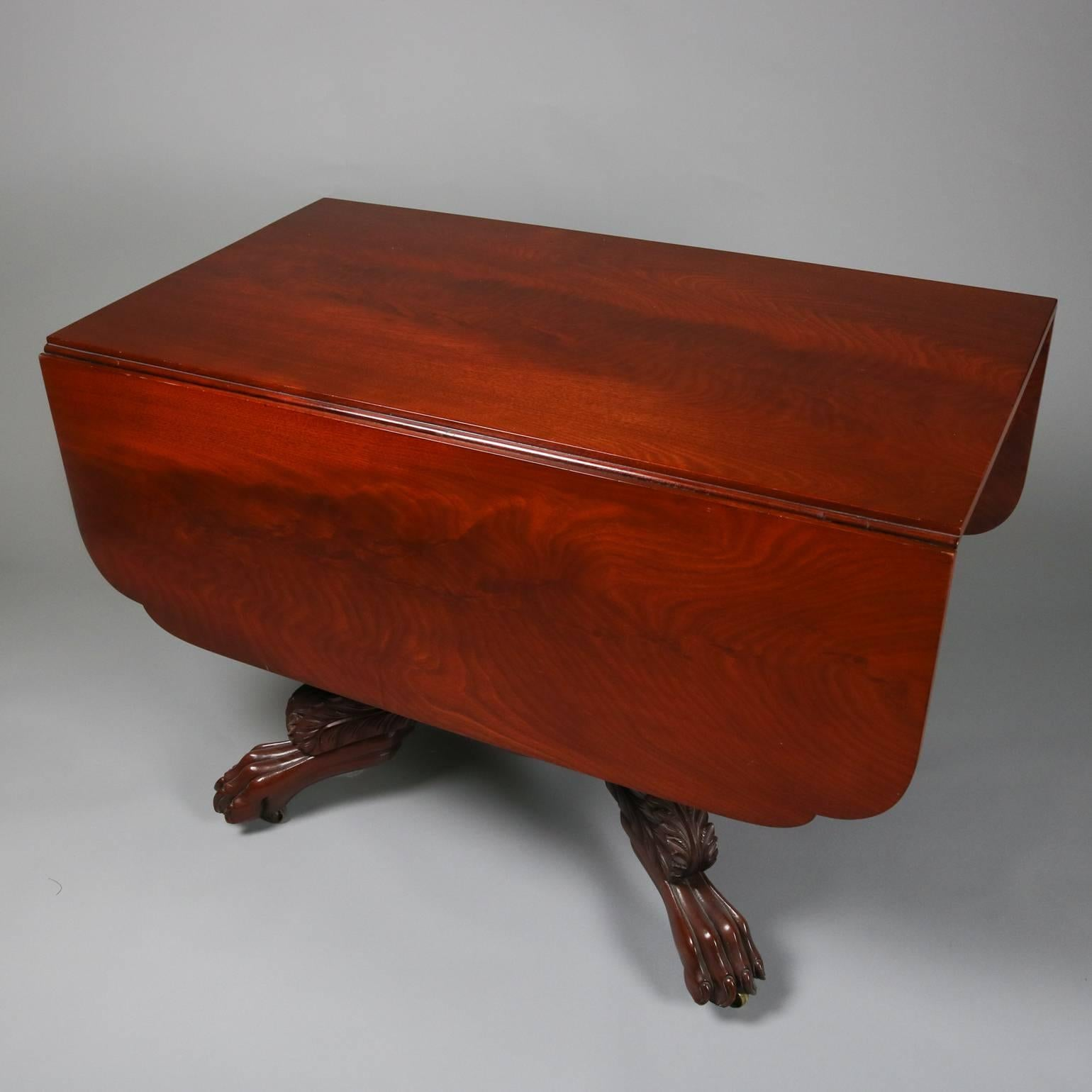 Antique Carved American Empire Flame Mahogany Pedestal Drop Leaf Table In  Good Condition For Sale