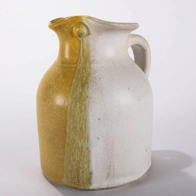 Mid-Century Modern hand-thrown pitcher features tri-color glaze with mustard yellow, avocado green and eggshell, signed T. Randall, mid-20th century Provenance: Deaccessioned from the Randy Webb Collection of the Call Museum of Hartsville, New York,