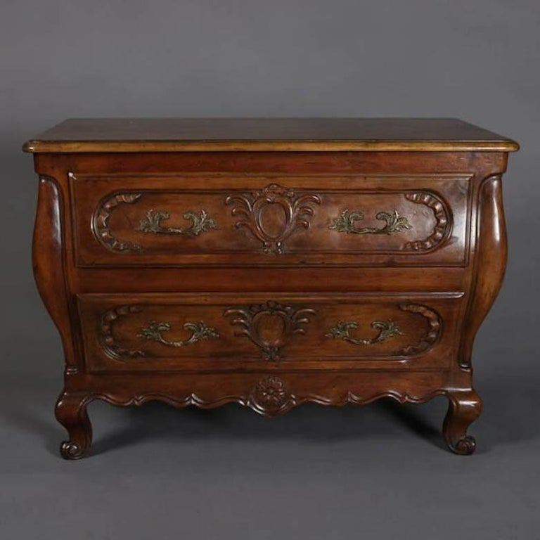 Carved mahogany baker french bombe style two drawer chest for French furniture designers 20th century