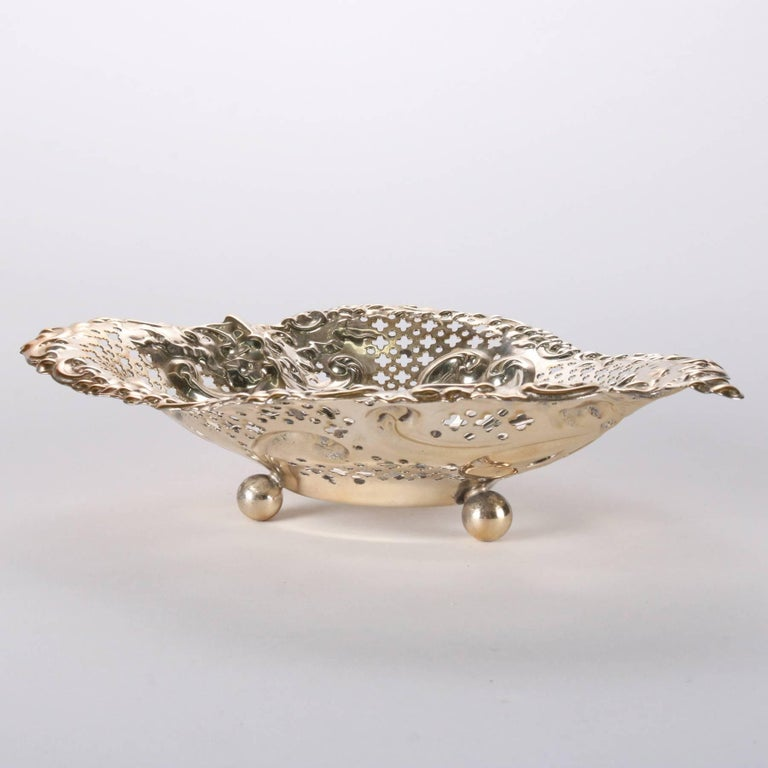 Antique Gorham sterling silver dish features reticulated heart shaped bowl seated on ball feet, monogram, 9.39 toz