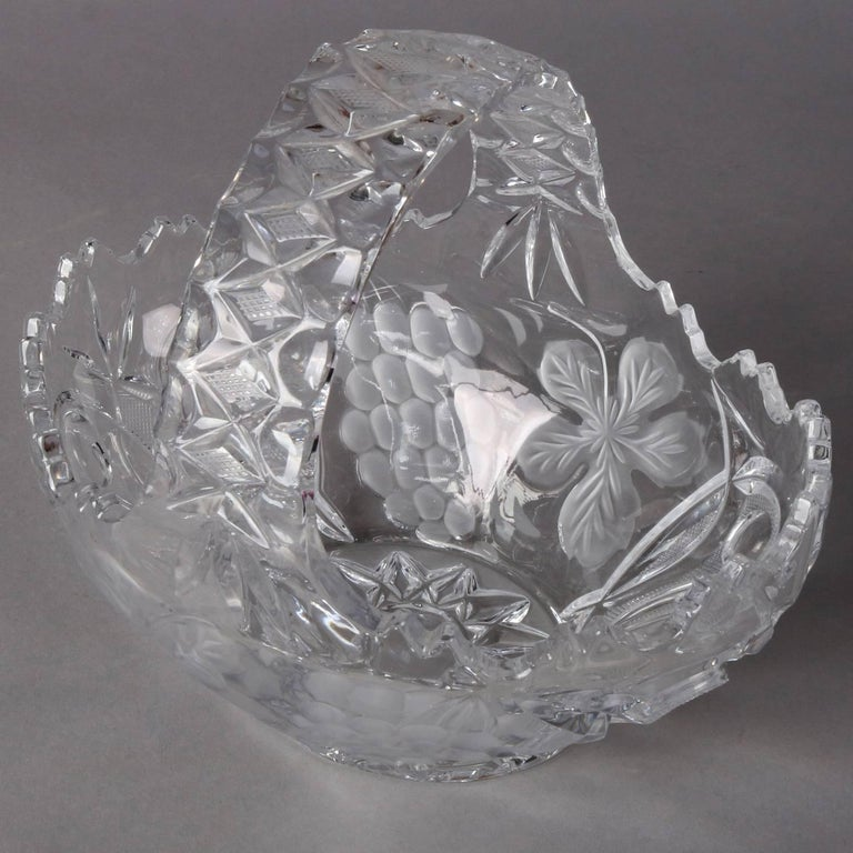 Hawkes School cut and pressed crystal basket features etched grape and floral decoration, 20th century.   Measures: 9