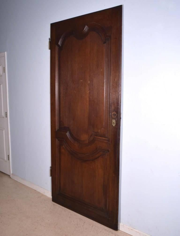 This elegant antique door is from France and it dates to the late 1700s or  early - Antique French Oak Wood Door From The 1700s Or Early 1800s For Sale