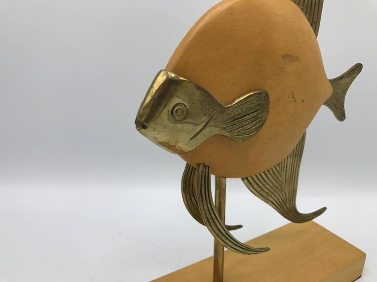 Offered is a beautiful, 1970s Sarreid style brass and wood mounted fish sculpture.