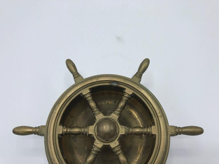 Offered is a gorgeous, 1950s Italian brass nautical ship wheel ashtray. Rubber bumper on the underside, easy grip to surfaces. Heavy. Marked: Italy.