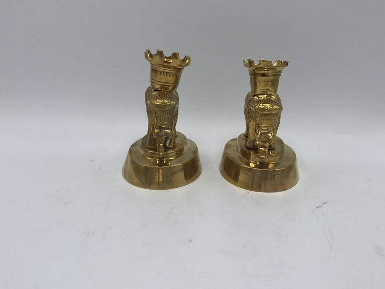 Offered is a beautiful, pair of 1970s Mottahedeh solid-brass elephant sculpture candlestick holders. Original tag on underside of one elephant.
