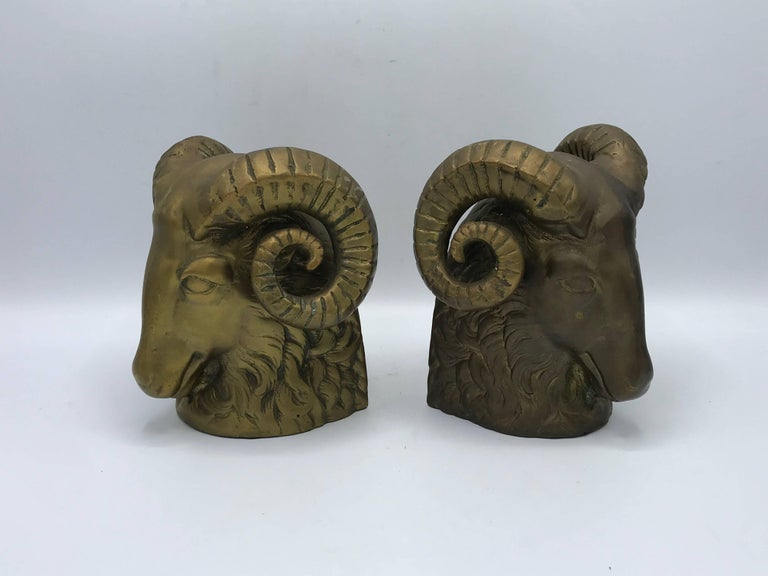 Offered is a pair of 1970s brass ram's head sculpture bookends. Heavy, 6 pounds each.