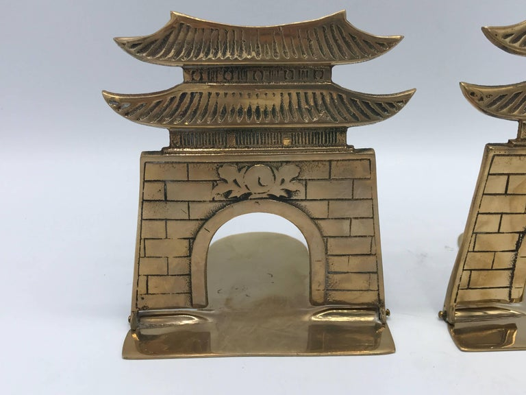 Offered is a gorgeous, pair of 1970s brass pagoda bookends.