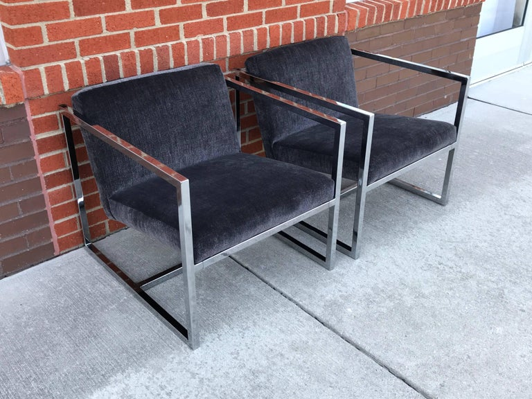 Offered is a fabulous, pair of 1980s Milo Baughman style polished-chrome cube chairs. The pair have been newly reupholstered in a gray Scalamandre velvet. Professional upholstery included new foam too. Heavy. Measure: Arm height is 23in.