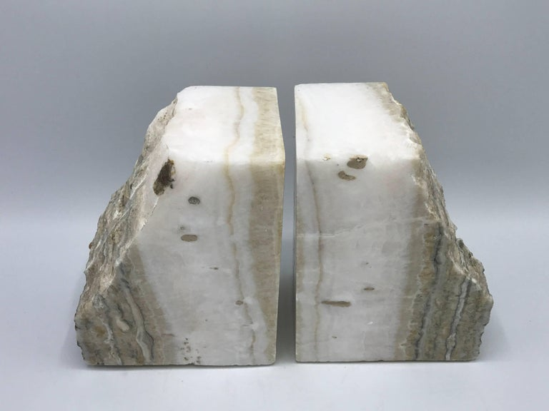 Offered is a gorgeous pair of 1950s white stone bookends. Extremely heavy.