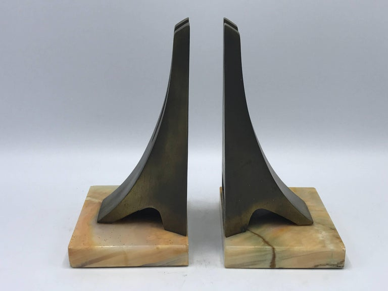 Offered is a gorgeous, pair of 1970s W. Macowski modern sculptural bookends mounted on onyx platforms. Marked on backside, 1971.