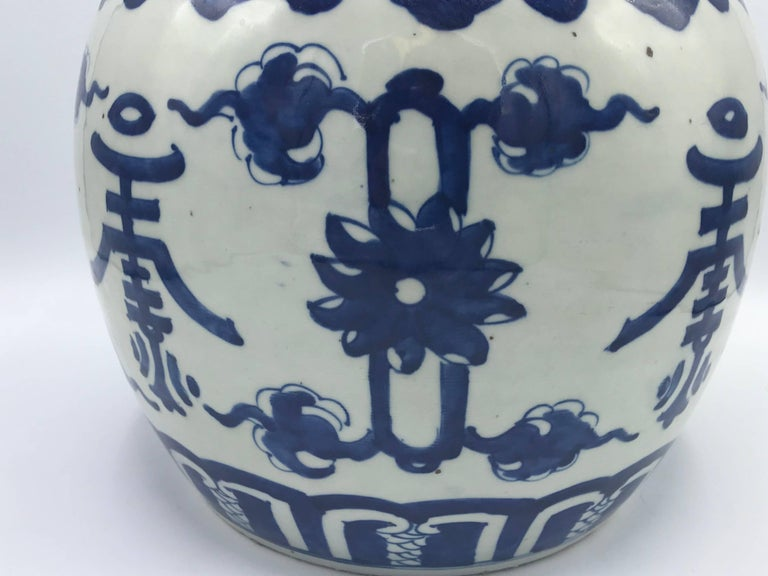 Offered is a gorgeous, late 19th century, large, blue and white ginger jar with ornate Asian symbols on all sides. No cracks, discoloration, or chips. 4.25