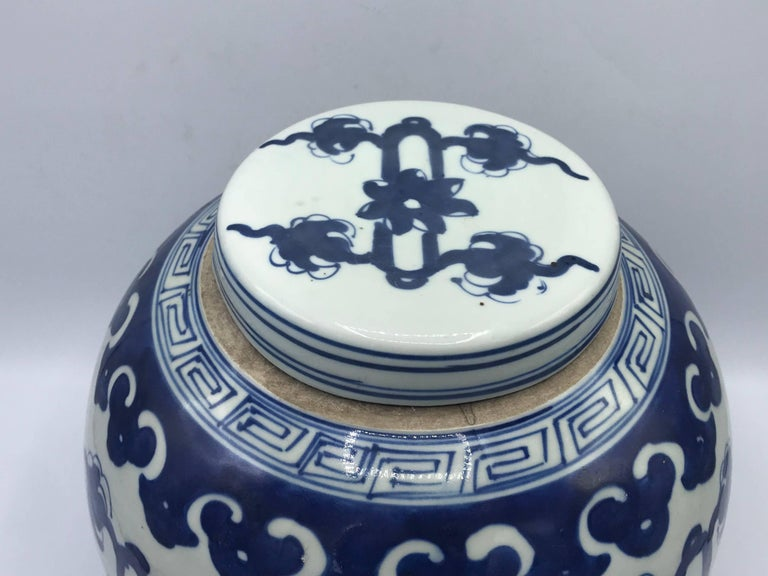 Chinoiserie 19th Century Blue and White Ginger Jar with Ornate Symbol Motif For Sale
