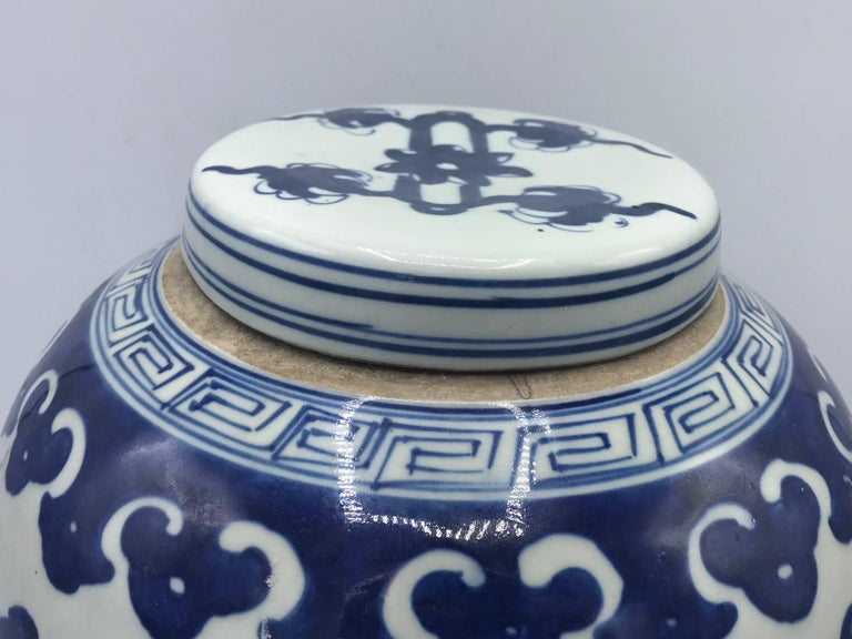 Fired 19th Century Blue and White Ginger Jar with Ornate Symbol Motif For Sale