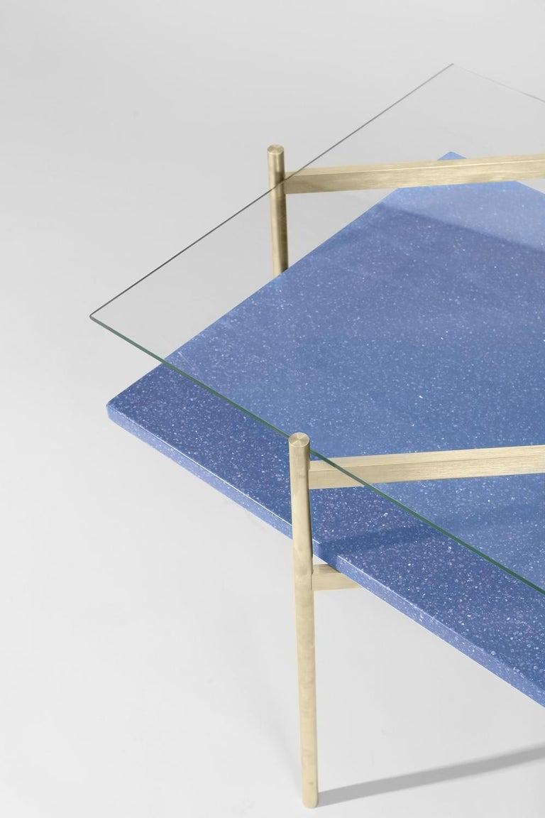 Made to order. Please allow six weeks for production.  Brass frame / Clear glass / Blue mosaic.  The Duotone Furniture series is based on a modular hardware system that pairs sturdy construction with visual lightness and a range of potential