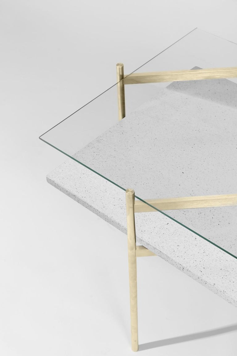 Made to order. Please allow six weeks for production.  Brass Frame / Clear Glass / White Mosaic  The Duotone Furniture series is based on a modular hardware system that pairs sturdy construction with visual lightness and a range of potential