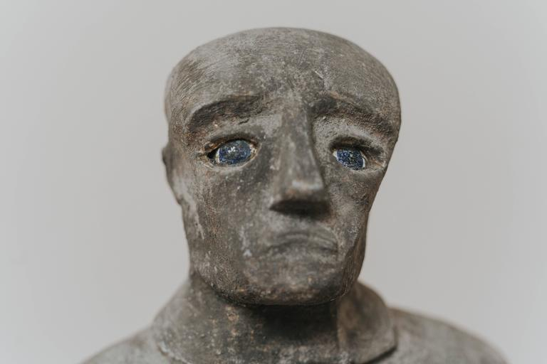 Resin figure of a blue eyed man.