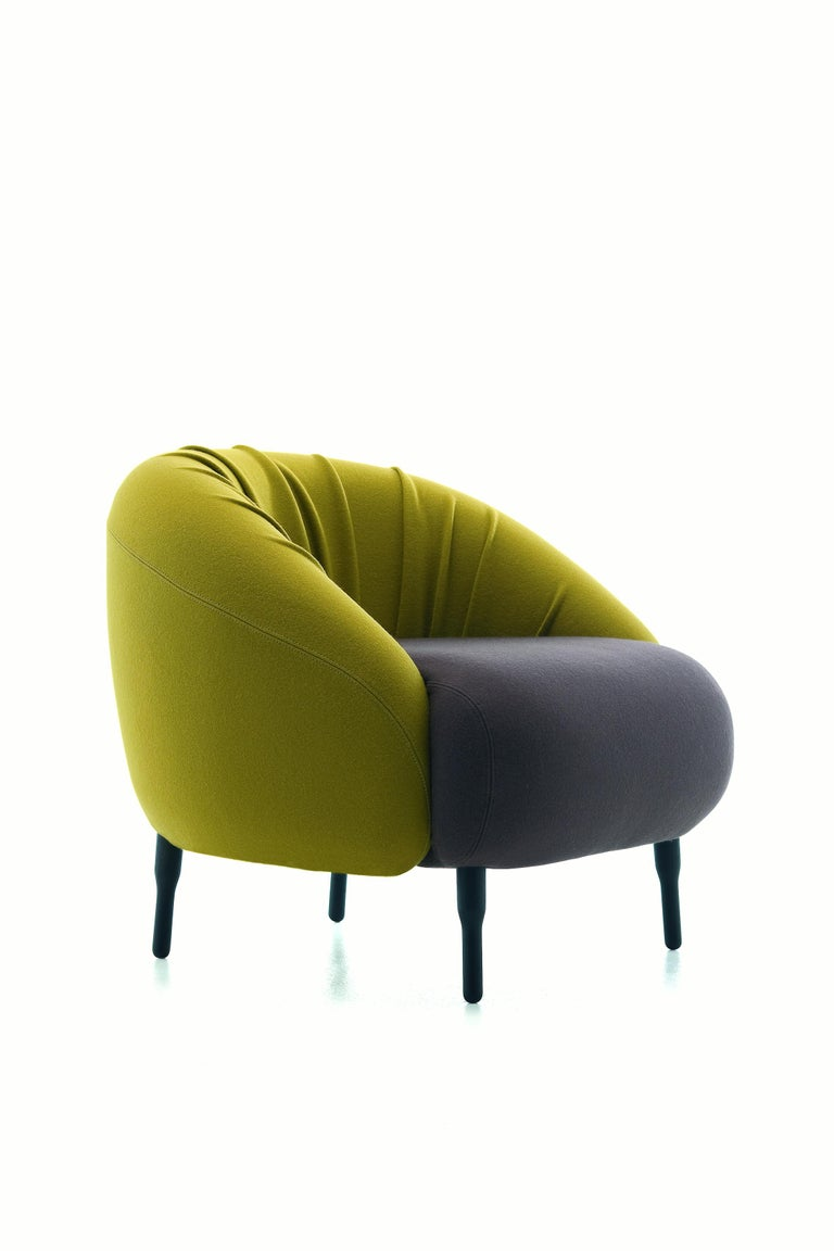 Introducing the versatile and very friendly Bump chair, the perfect solution for hotels and lounges. Available in alternative approaches to upholstery - one with a classic tight fit, and the other with excess fabric across the back. Illustrated in